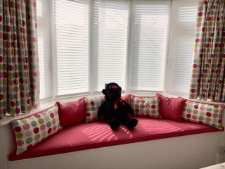 bay window with matching curtains and cushions